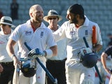 England's Monty Panesar and Matt Prior leave the field after securing a draw with NZ on March 26, 2013