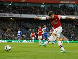 Olivier Giroud scores his team's third against Reading on March 30, 2013