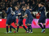 Paris Saint Germain players celebrates after grabbing a late goal against Montpellier on March 29, 2013
