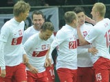 Poland players celebrate after a penalty by Robert Lewandowski in the game with San Marino on March 26, 2013