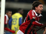 AC Milan's Riccardo Montolivo celebrates after scoring the opening goal against Chievo on March 30, 2013