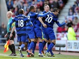 Robin Van Persie celebrates with team mates after scoring the opener against Sunderland on March 30, 2013