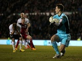 Derby's Jamie Ward holds his head in his hands after having his penalty kick saved by Bristol City keeper Tom Heaton on March 29, 2013