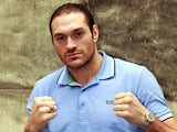 Tyson Fury poses for photos after a press conference on March 7, 2013