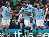 Vincent Kompany is congratulated by team mates after scoring his team's third against Newcastle on March 30, 2013