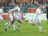England's Wayne Rooney celebrates scoring an early header against Montenegro on March 26, 2013