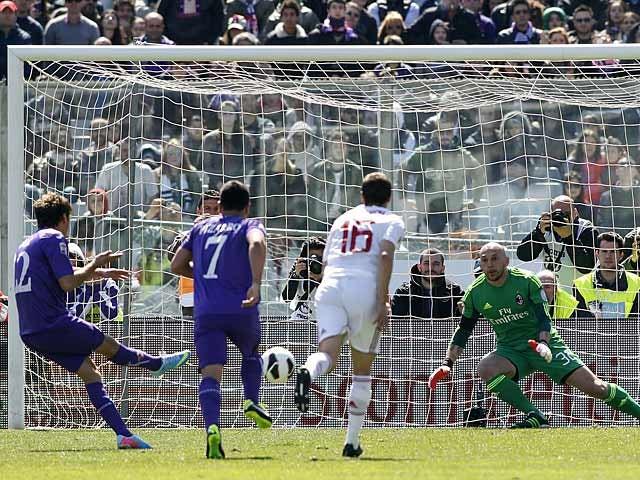 Fiorentina's Adem Ljajic scores a penalty against AC Milan in April 7, 2013