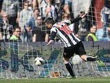 Udinese's Antonio Di Natale nets the opening goal against Chievo on April 7, 2013