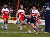 Wigan Warriors' Blake Green scores a touchdown against Hull KR on April 1, 2013