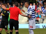 Referee Phil Dowd instructs Bobby Zamora to leave the field moments after showing him a red card in the match against Wigan on April 7, 2013