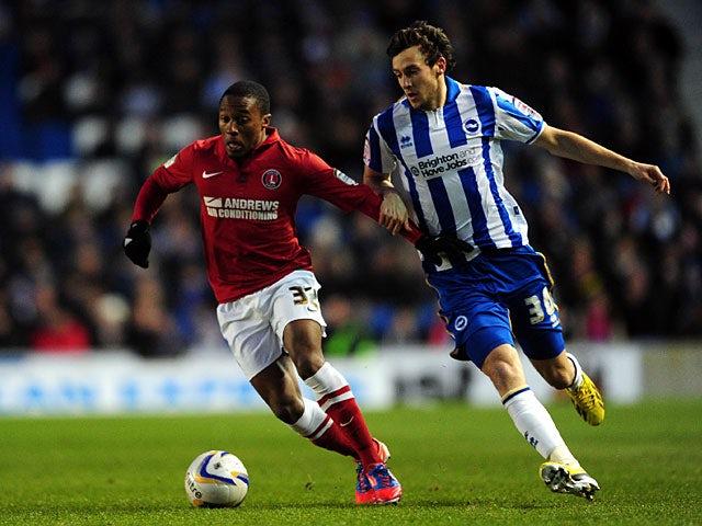 Charlton's Callum Harriott and Brighton's Will Buckley battle for the ball on April 2, 2013