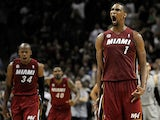 Miami Heat's Chris Bosh celebrates after scoring the winning basket against San Antonio Spurs on March 31, 2013