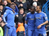 Chelsea players congratulate Demba Ba after his goal against Man Utd on April 1, 2013