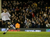 Dimitar Berbatov scores the opening goal from the penalty spot against QPR on April 1, 2013