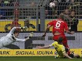 Augsburg's Kevin Vogt scores against Borussia Dortmund on April 6, 2013