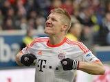 Bayern Munich player Bastian Schweinsteiger celebrates after scoring against Eintracht Frankfurt on April 6, 2013