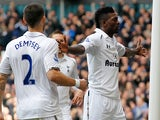 Emmanuel Adebayor is congratulated by team mate Clint Dempsey after scoring the opening goal against Everton on April 7, 2013