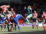 Doncaster's Jamie McCombe scores the winning goal against Swindon on April 1, 2013