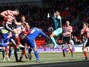 Doncaster's Jamie McCombe scores the winning goal against Swindon on April 1, 2013