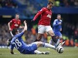 Man Utd's Javier Hernandez is challenged by Chelsea defender Cesar Azpilicueta on April 1, 2013