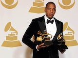 Rapper Jay-Z poses backstage at the Grammy Awards on February 10, 2013