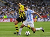 Malaga's Jeremy Toulalan fends off a challenge during his side's match against Dortmund on April 3, 2013
