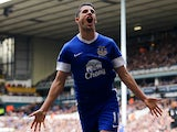 Kevin Mirallas celebrates moments after scoring his team's second goal against Spurs on April 7, 2013