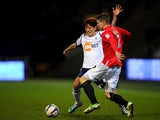 Bolton's Lee Chung-Yong and Huddersfield's Calum Woods battle for the ball on April 2, 2013