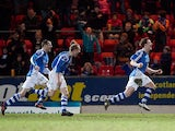 St Johnstone's Liam Craig is joined by team mates after grabbing a late equaliser against Dundee United on April 1, 2013