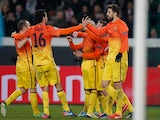 Barcelona's Lionel Messi is congratulated by team mates after scoring the opening goal against Paris Saint-Germain on April 2, 2013