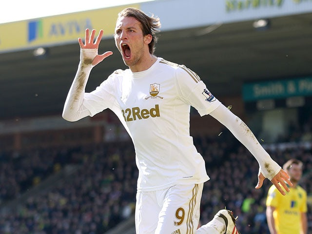 Swansea City forward Michu celebrates after scoring against Norwich in the Premier League match on April 6, 2013