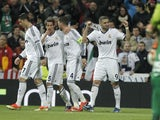 Real Madrid's Karim Benzema celebrates after scoring his side's second goal in their Champions League match against Galatasaray on April 3, 2013