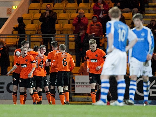 Dundee United's Ryan Gauld is congratulated by team mates after scoring the opener against St Johnstone on April 1, 2013