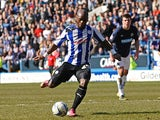 Sheffield Wednesday's Leroy Lita scores from the penalty spot against Blackburn Rovers on April 6, 2013