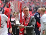Crewe boss Steve Davis with Johnstone's Paint Trophy on April 7, 2013