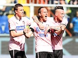Palermo's Steve Von Bergen is congratulated by team mates after scoring the opening goal against Sampdoria on April 7, 2013
