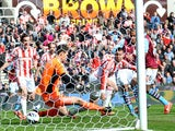 Aston Villa's Gabriel Agbonlahor beats Stoke City goalkeeper Asmir Begovic to score their first goal during the Premier League match on April 6, 2013