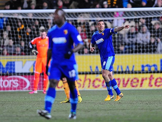 Watford's Troy Deeney celebrates after scoring the opening goal against Hull on April 2, 2013
