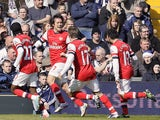 Arsenal's Tomas Rosicky celebrates after scoring against West Bromwich Albion on April 6, 2013