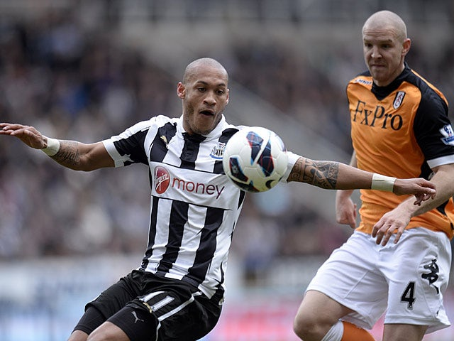 Yoan Gouffran and Philippe Senderos battle for the ball on April 7, 2013