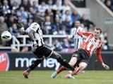 Sunderland's Adam Johnson scores the second goal against Newcastle on April 14, 2013