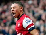 Arsenal's Alex Oxlade-Chamberlain celebrates after Norwich score an own goal and his team's third on April 13, 2013