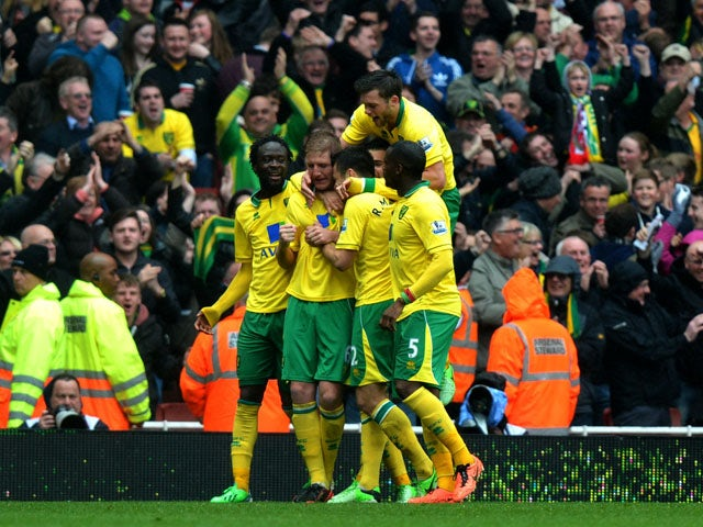 Norwich's Michael Turner celebrates scoring during the Premier League clash with Arsenal on April 13, 2013