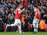 Arsenal's Lukas Podolski celebrates scoring during the Premier League clash with Norwich on April 13, 2013