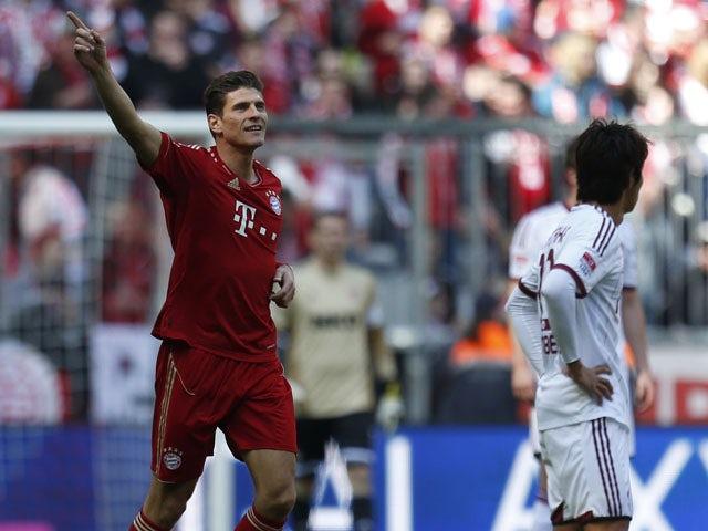 Bayern Munich's Mario Gomez celebrates after scoring against FC Nuremberg in the Bundesliga clash on April 13, 2013