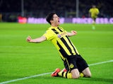 Borussia Dortmund's Robert Lewandowski celebrates scoring against Malaga on April 9, 2013