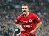 Wigan's Callum McManaman celebrates after scoring his team's second against Millwall on April 13, 2013