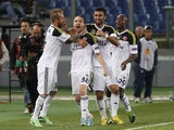 Fener's Caner Erkin celebrates with teammates after scoring a goal Lazio on April 11, 2013
