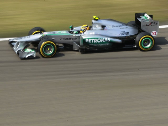 Hamilton: 'Too early for title focus'