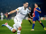 Spurs' Clint Dempsey celebrates a goal against Basle on April 11, 2013